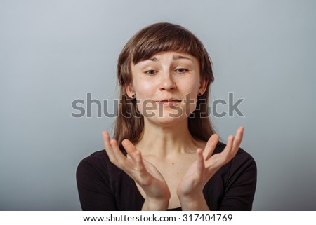 girl holding something very fragile - stock photo