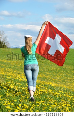 Girl holding Swiss flag. Emmental, Switzerland  - stock photo