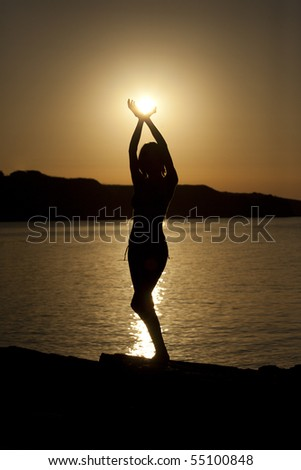 girl holding the sun - stock photo