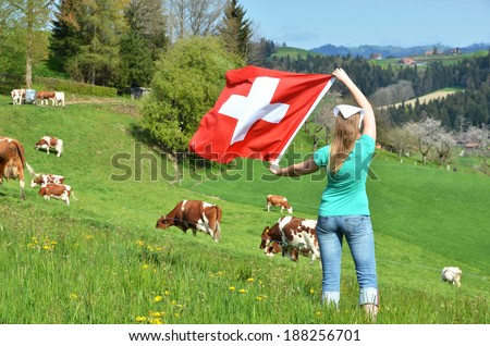 Girl holding the Swiss flag. Emmental, Switzerland - stock photo