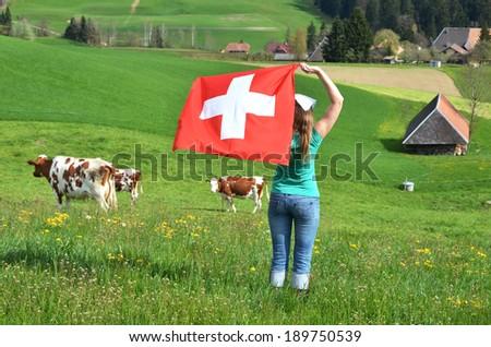 Girl holding the Swiss flag. Emmental, Switzerland  - stock photo