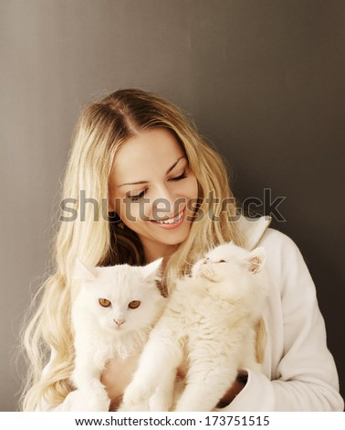 Girl holding two adorable Persian cats - stock photo