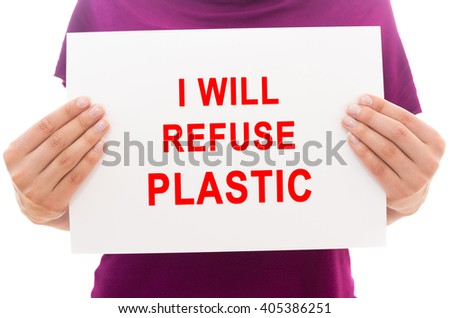 Girl holding white paper sheet with text I will refuse plastic - stock photo