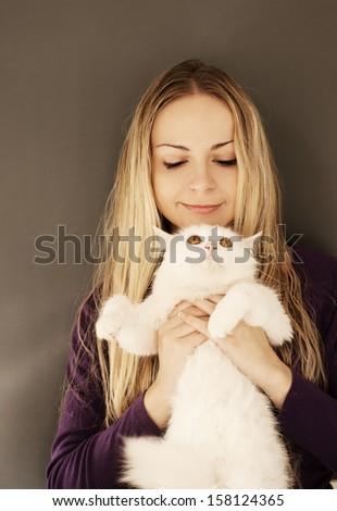 Girl holding white Persian cat - stock photo
