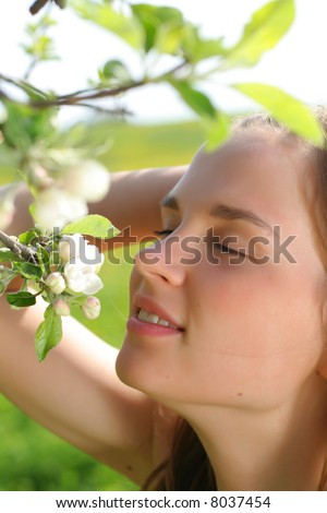 Girl holds apple flowers and smile - very cute portrait