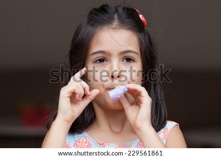 Girl Holds Blower - stock photo