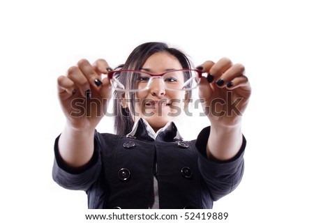 girl holds hands points and looks in points - stock photo