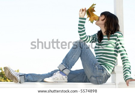 Girl holds leafs - stock photo