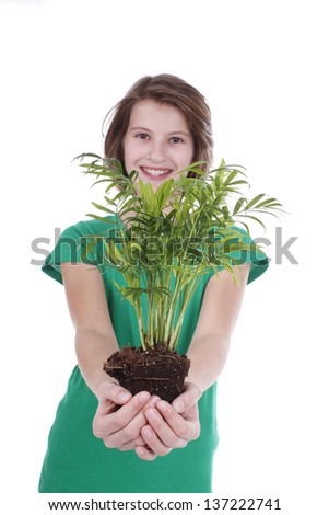 Girl holds small plant