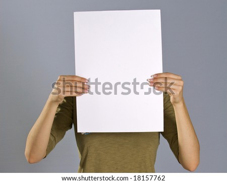 Girl holds swollen the sheet of the white paper