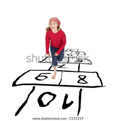girl hopping around playing hopscotch - stock photo