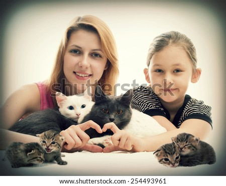 Girl hugging cats and show hands heart