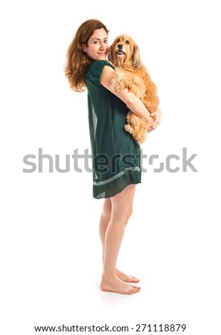 Girl hugging her dog - stock photo