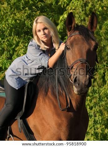 Girl hugging her horse - stock photo