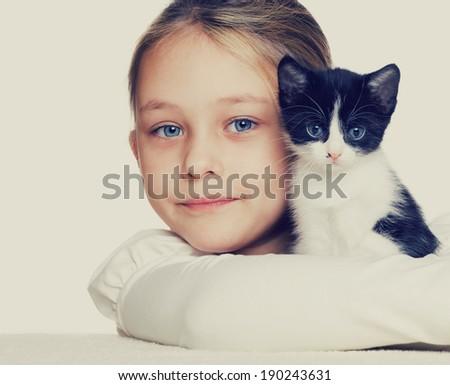 girl hugging kitten - stock photo