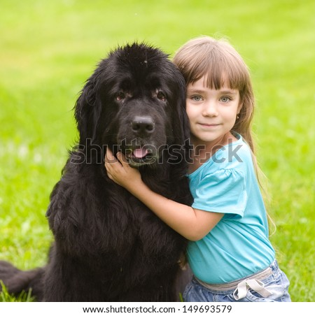 girl hugging Newfoundland dog - stock photo