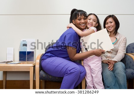 Girl hugging nurse - stock photo