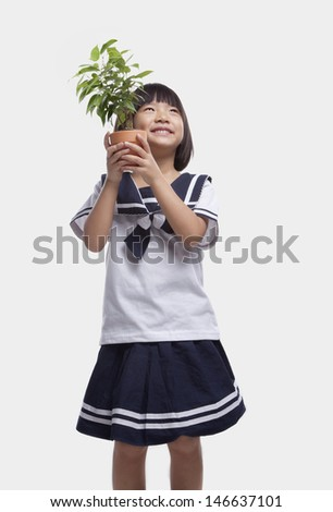 Girl Hugging Potted Plant