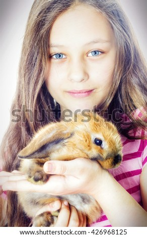 Girl hugging rabbit - stock photo