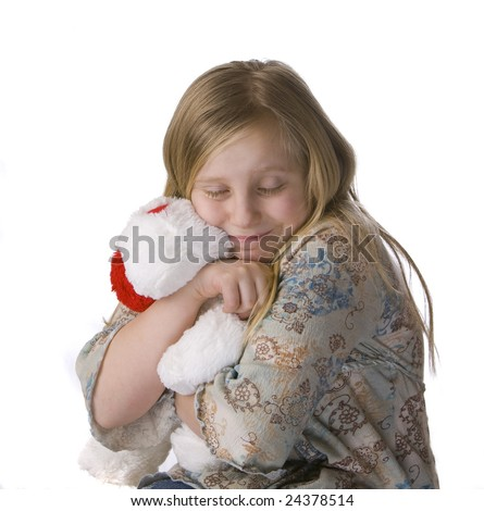 Girl hugging stuffed animal on white background - stock photo