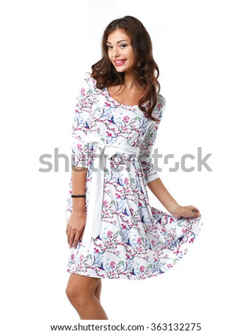 girl in a beautiful dress posing on a white background - stock photo