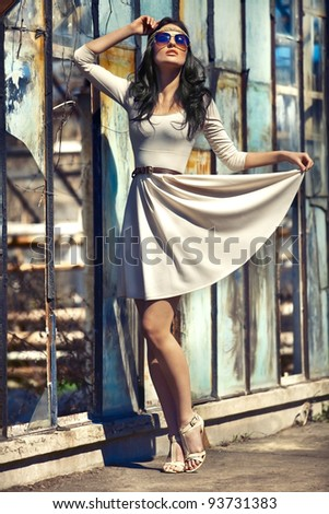 Girl in a beige dress and sunglasses - stock photo