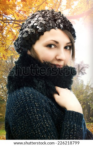 girl in a beret in autumn