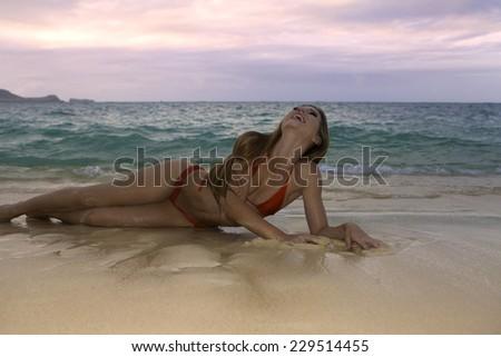 girl in a bikini on a hawaii beach - stock photo