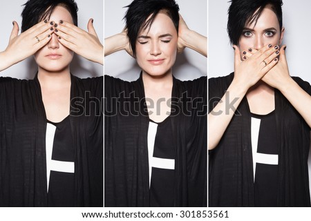 Girl in a black dress with shaved head in art gothic style. Picture taken in the studio on a white background. I can not see, can not hear, do not speak - stock photo