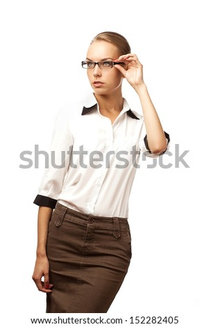 girl in a blouse looks upwards