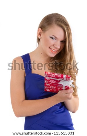 girl in a blue dress with long hair with a Christmas gift in hands