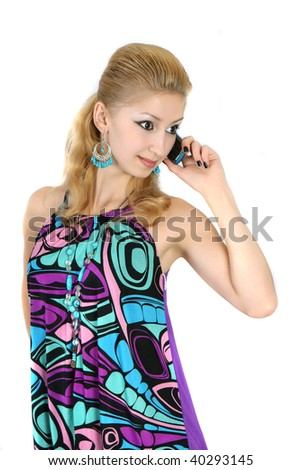 girl in a bright dress with a phone - stock photo