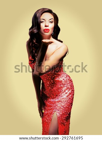 girl in a brilliant dress sends a kiss. Isolated on background. Retro Style - stock photo