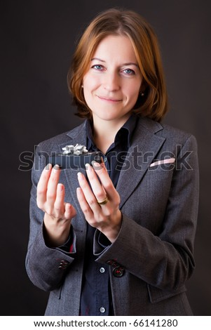 Girl in a business suit with a gift in a hands - stock photo