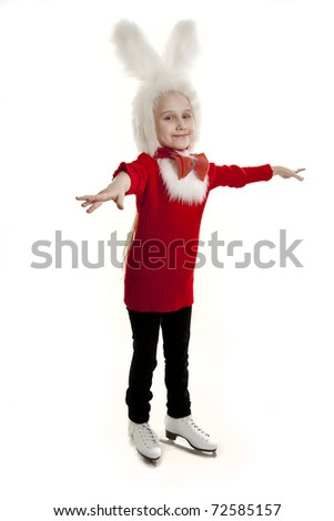 Girl in a cap of a bunny standing on the skates - stock photo