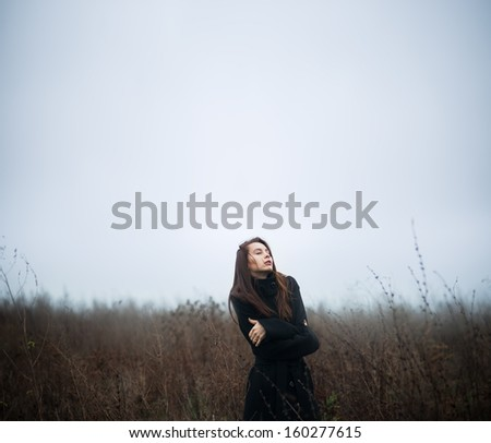 girl in a coat on the field
