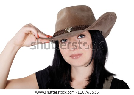 girl in a cowboy hat isolated on white background - stock photo