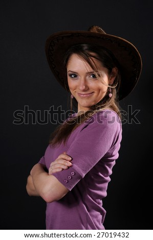 Girl in a cowboy's hat - stock photo