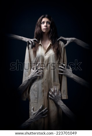 girl in a dirty robe, hand of death, nightmares, insomnia, a mentally ill woman, halloween theme, creepy dream, hands of the demon, hands of the devil in the smoke, horror movie scene with a girl,fear - stock photo