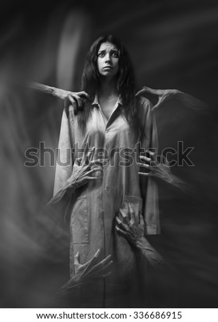 girl in a dirty robe, hand of death, nightmares, insomnia, a mentally ill woman, halloween theme, creepy dream, hands of the demon, hands of the devil in the smoke, black and white photography - stock photo