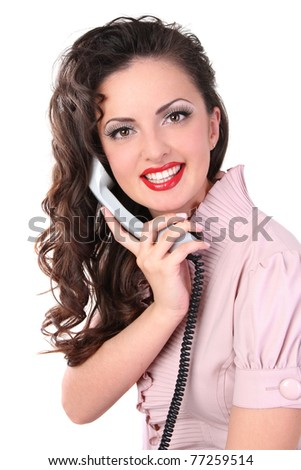 girl in a dress talking on the phone and smiling