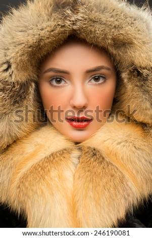 Girl in a fur hood - stock photo