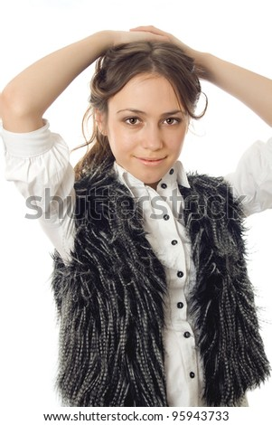 girl in a fur vest posing isolated on white background - stock photo