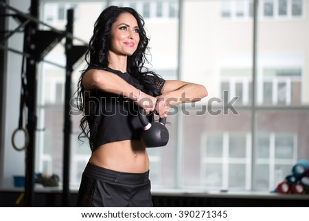 girl in a gym performing sports exercises - stock photo
