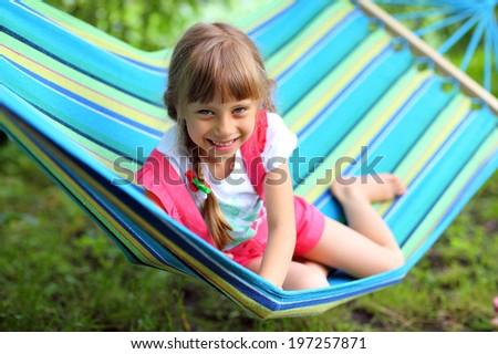 Girl in a hammock in the garden - stock photo