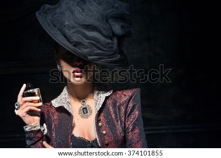 Girl in a hat trying fresh perfume - stock photo