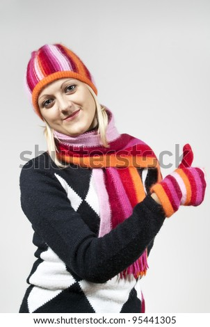 girl in a hat with a scarf and gloves on the background - stock photo
