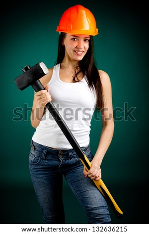 Girl in a helmet with a sledgehammer - stock photo