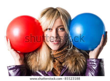 girl in a jacket holding a red and blue balls - stock photo
