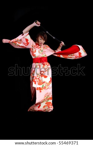 girl in a japanese kimono in action with nunchuck - stock photo